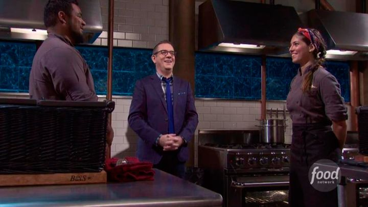 <p>Facing her opponent in the final round of an episode of <em>Chopped</em>.</p>
