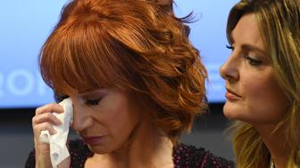Comedian Kathy Griffin (L) reacts during a news conference to discuss the comedian's 'motivation' behind a photo of her holding what appeared to be a prop of the bloodied head of President Donald Trump, with her her attorney, Lisa Bloom (R) in Woodland Hills, California on June 02, 2017. / AFP PHOTO / Mark RALSTON        (Photo credit should read MARK RALSTON/AFP/Getty Images)