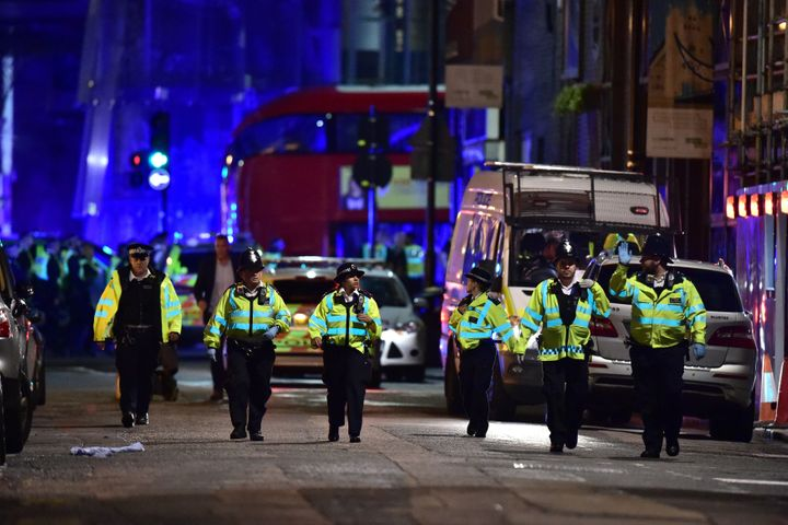 Police officers on Borough High Street in London as authorities responded to Saturday night's terrorist attack.