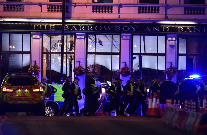 Police Officers outside the Barrowboy and Banker Public House on Borough High Street as police were dealing with a