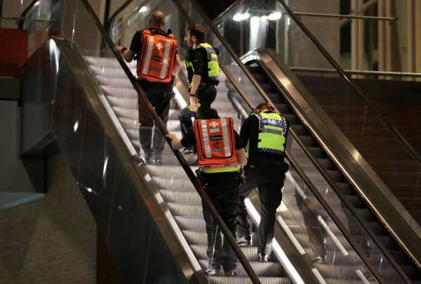 Medics make their way up the escalator by The Shard