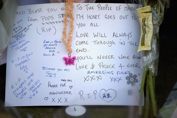 Messages are left amongst tributes by members of the public in St. Ann's Square on Tuesday May 23, 2017 in Manchester.