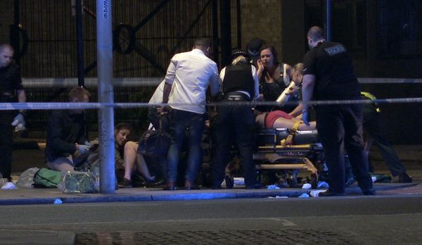 People receive medical attention in Thrale Street near London Bridge