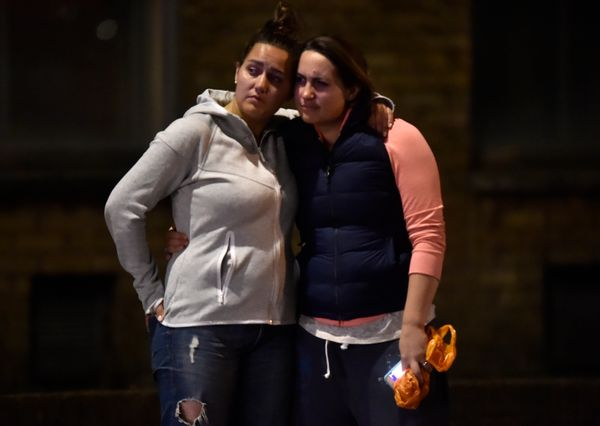 Women embrace after an incident near London Bridge