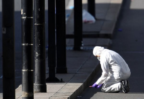 A police forensics investigator works on London Bridge.