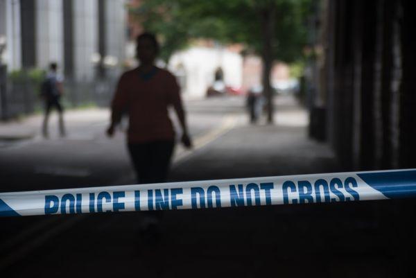 Police forensics officers work on London Bridge.