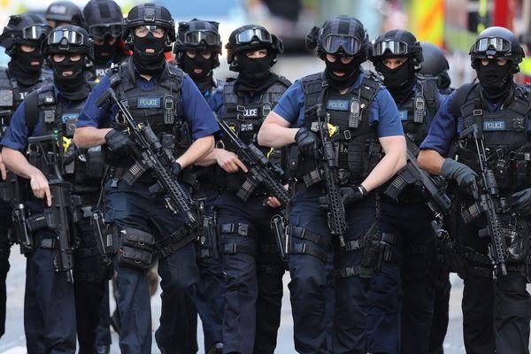 Counterterrorism officers march near the scene of a terrorist attack on London Bridge.