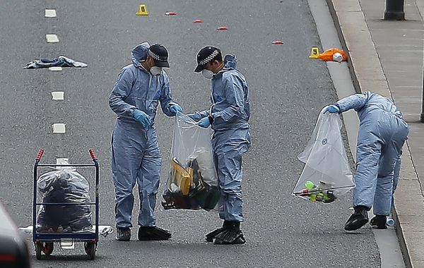 Police forensic officers work and collect evidence on London Bridge as police continue their investigations.