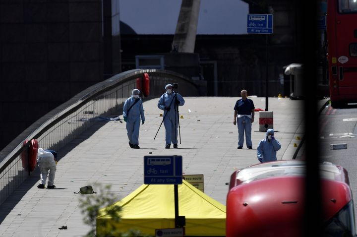 Police forensic investigators collect evidence on London Bridge on Sunday