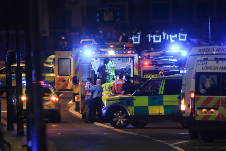Members of the emergency services attend to victims of a terror attack which began on London Bridge.
