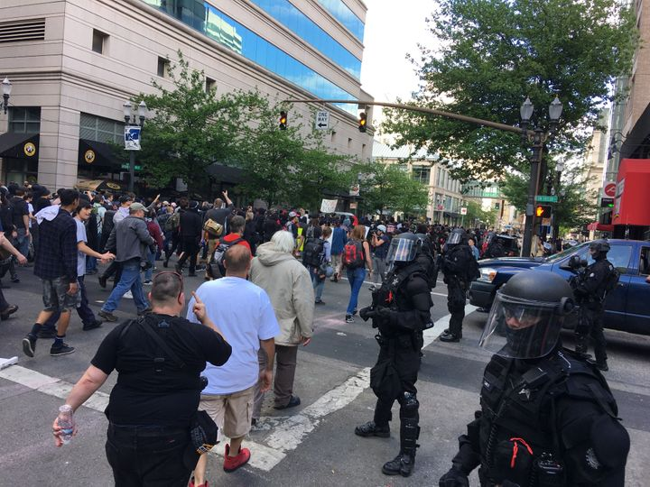 Anti-fascist protestors and others storm the streets north of City Hall.