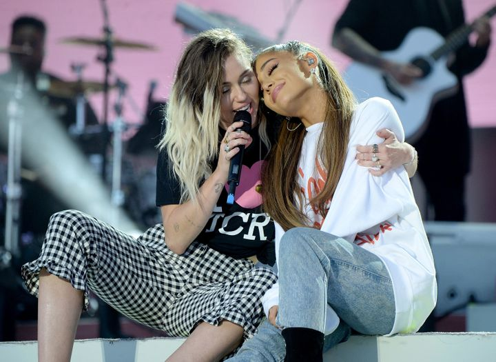 Ariana Grande on stage with her friend Miley Cyrus at One Love Manchester