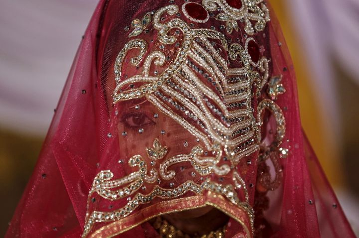 A Muslim bride waits to take vows that could be instantly broken via SMS.