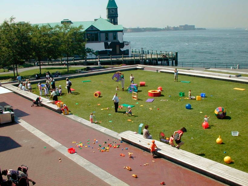 The lawn at Robert F. Wagner, Jr. Park depicted in one of its many manifestations - here a playground.