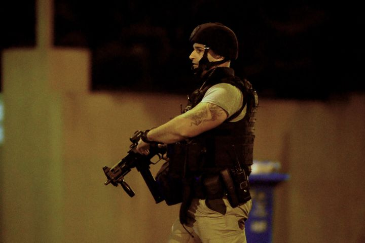 An armed police officer walks at the scene in the Melbourne bayside suburb of Brighton on June 5, 2017, after a woman was hel