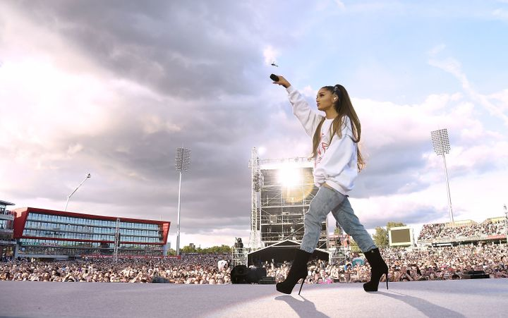 """Ariana Grande performs at the""""One Love Manchester"""" benefit concerton Sunday."""