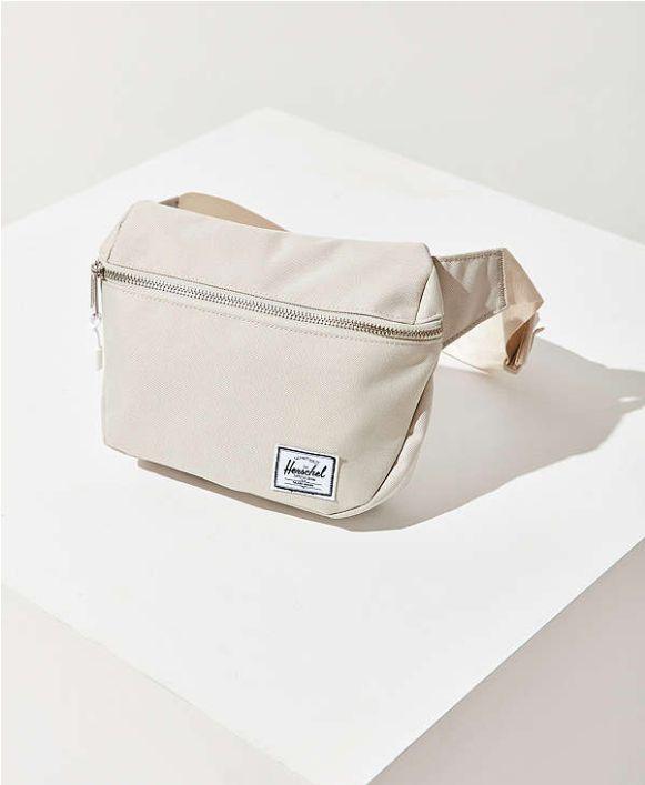 """Buy the <a href=""""https://www.urbanoutfitters.com/shop/herschel-supply-co-x-uo-fifteen-belt-bag?adpos=1o1&cm_mmc=SEM-_-Goo"""