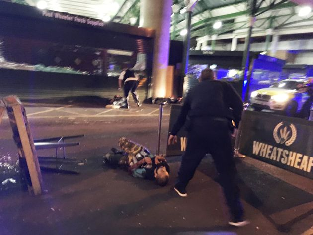 Anattacker, believed to be Khuram Shazad Butt, isseen on the ground after armed police officers...