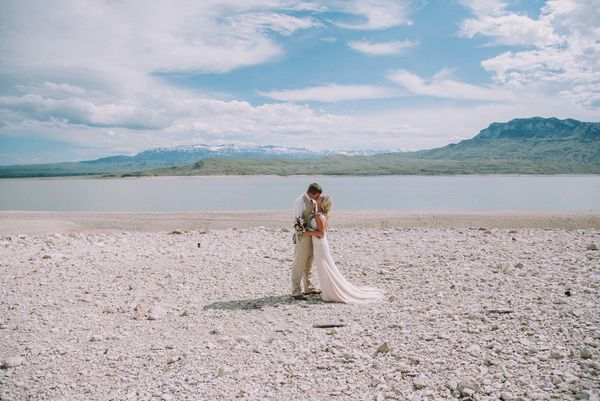 """""""Sarah and Ryan married at Wayfarer's Chapel outside of Yellowstone National Park. Mountain backdrop, trees and flowing water"""