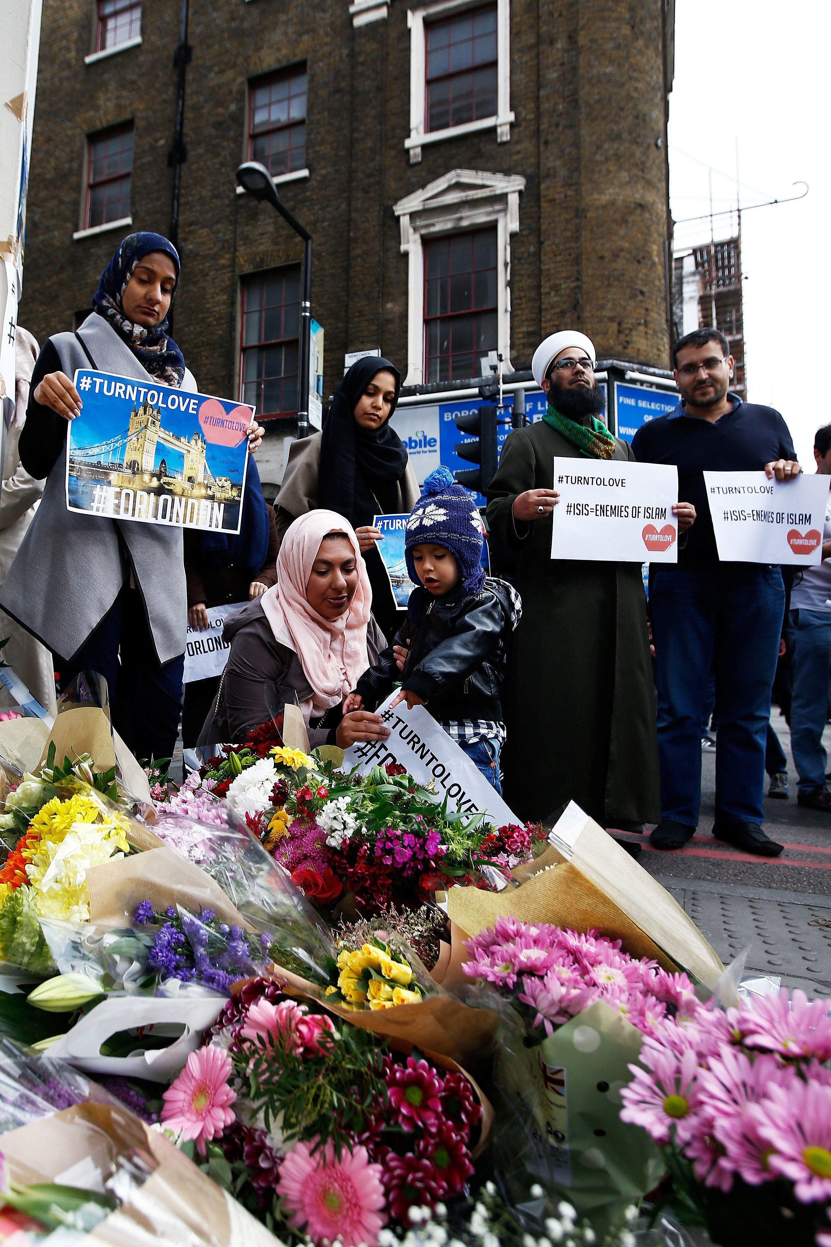 Muslims pray at a floral tribute near London Bridge, after attackers rammed a hired van into pedestrians on London Bridge and stabbed others nearby killing and injuring people, in London, Britain June 4, 2017. REUTERS/Peter Nicholls