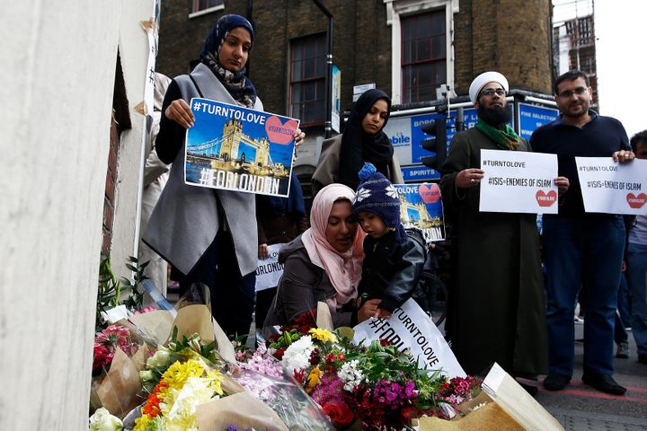 Muslims pray at a floral tribute near London Bridge, after attackers rammed a hired van into pedestrians on London Bridge and