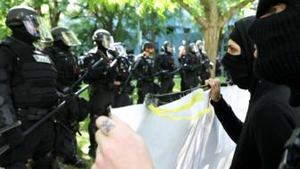 June 4, 2017 - Portland, Oregon USA:  Four large and nearly simultaneous protests drew thousands to Portland's City Hall and three nearby parks While tempers ran high, only 14 people were arrested and only trivial injuries reported. A demonstration organized by Joey Gibson, of Vancouver, claimed to support 'free speech' and Donald Trump; two contrary demonstrations -- one by Antifa 'Black Bloc' protesters -- opposed them as being 'alt-right' and fascist; and a fourth showed organized labor's opposition to Trump and the alt right. John Rudoff