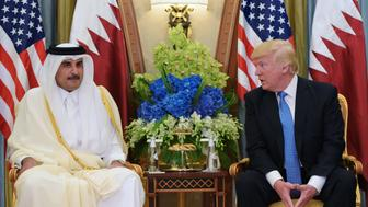 US President Donald Trump (R) and Qatar's Emir Sheikh Tamim Bin Hamad Al-Thani take part in a bilateral meeting at a hotel in Riyadh on May 21, 2017. / AFP PHOTO / MANDEL NGAN        (Photo credit should read MANDEL NGAN/AFP/Getty Images)