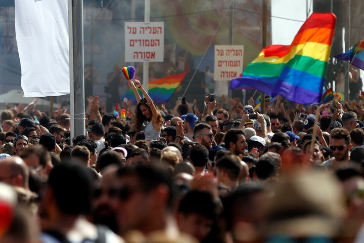 Revellers take part in a gay pride parade in Tel Aviv, Israel, June 3, 2016.