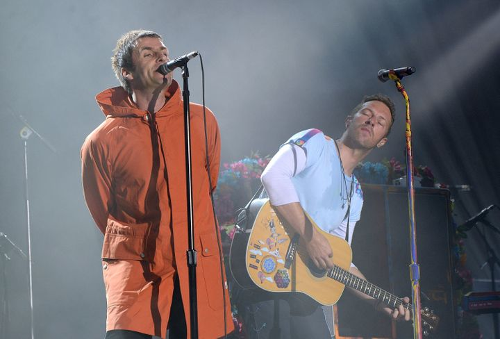 Liam Gallagher (L) and Chris Martin of Coldplay perform on stage during the One Love Manchester Benefit Concert on June 4, 20