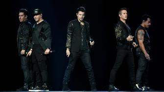 LAS VEGAS, NV - MAY 28:  (L-R) Singers Jonathan Knight, Donnie Wahlberg, Jordan Knight, Joey McIntyre and Danny Wood of New Kids on the Block perform during a stop of The Total Package Tour at T-Mobile Arena on May 28, 2017 in Las Vegas, Nevada.  (Photo by Ethan Miller/Getty Images)