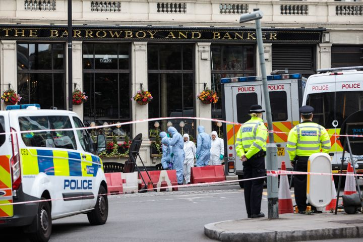 Forensic officers continue their work along Borough High Street Monday the Saturday terror attack in London.