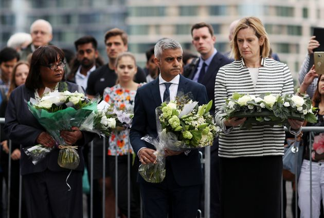 L-R: Shadow Home Secretary Diane Abbott, Khan and Home Secretary Amber Rudd lay flowers at the