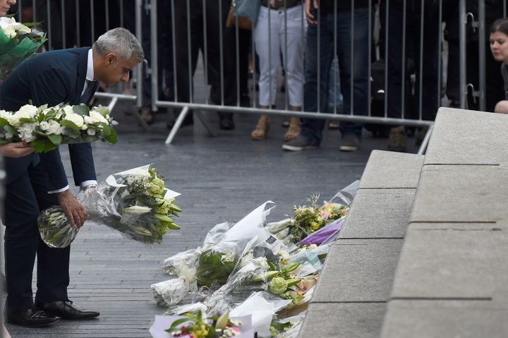 Khan lays flowers near the scene of the attack at London Bridge.