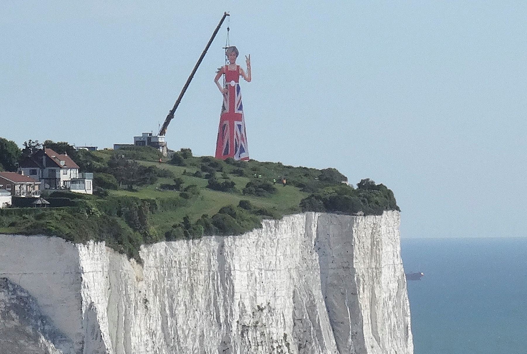 A giant scaffolding sculpture with an image of Britain's Prime Minister wearing the Union Flag and making a gesture towards continental Europe is seen on top of the cliffs overlooking the south coast of England and the Channel, June 5, 2017. REUTERS/Simon Hare