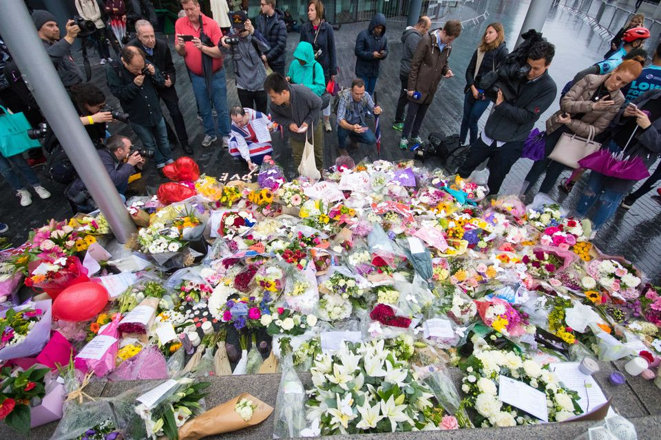 Members of the public lay flowers following a vigil at City Hall on June 05, 2017 in London, England. V