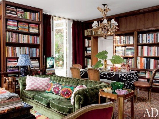 <p>In Sig Bergamin's São Paulo home, the library's Indian tablecloth and taffeta curtains were found in Paris; the Art Déco side table is from Malmaison.</p>