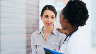 Cropped shot of a female doctor talking to a patient in the hospital