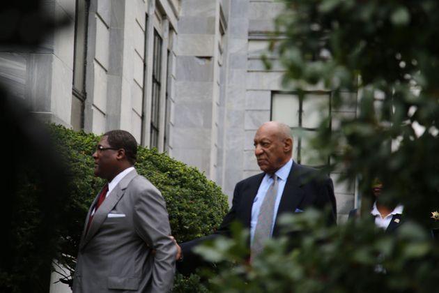 Bill Cosby walks into