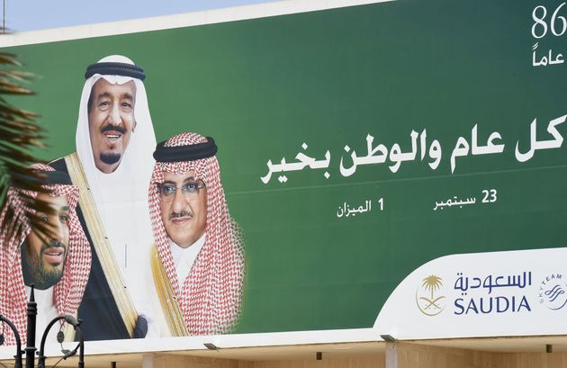 Aposter of Saudi King Salman (C), Crown Prince and Interior Minister Mohammed bin Nayef (R) and...