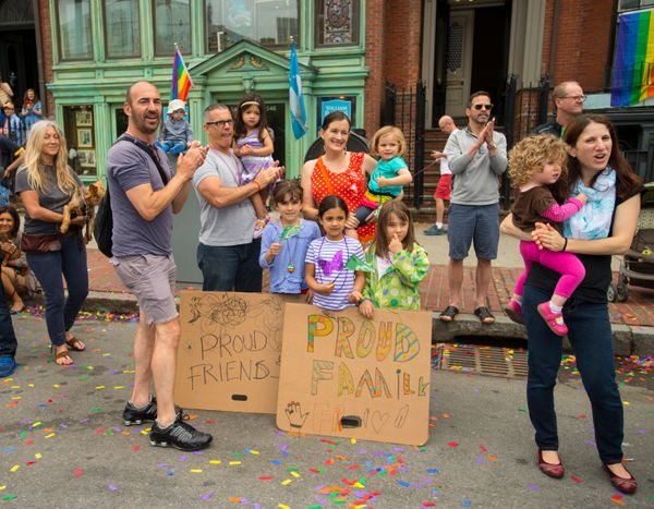 Families cheering on the Boston Pride parade in the South End of Boston, Massachusetts, on June 14, 2014. (Photo by Rick Frie