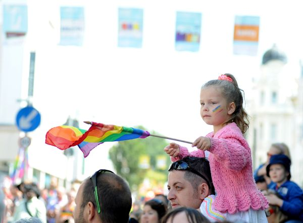 A young girl watches the parade during Brighton Pride 2015 on August 1, 2015 in Brighton, England. (Photo by Tabatha Fireman/