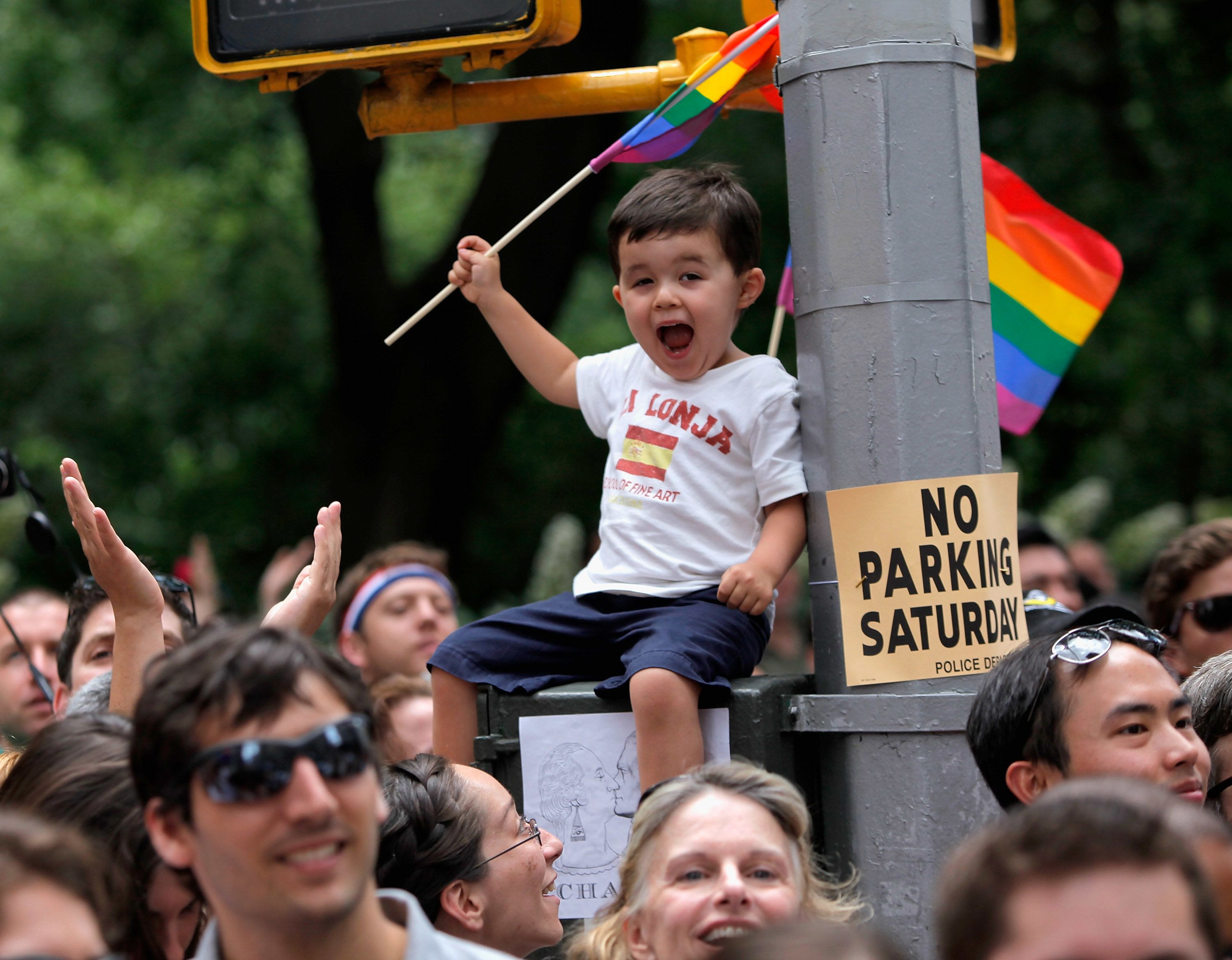 A young boy waves a flag during the 2011 NYC LGBT Pride march on the streets of Manhattan on June 26, 2011 in New York City.