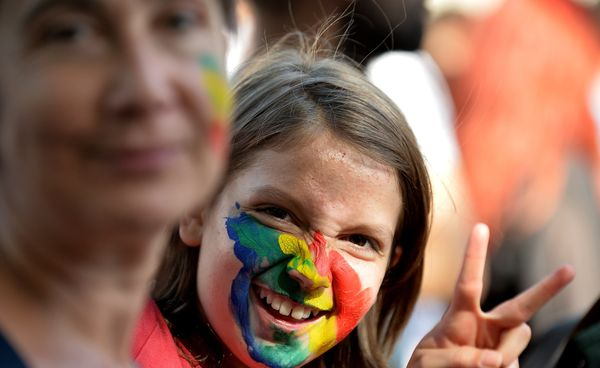 A young girl sporting rainbow colours takes part in the annual Gay Pride parade in Rome on June 7, 2014. (TIZIANA FABI/AFP/Ge