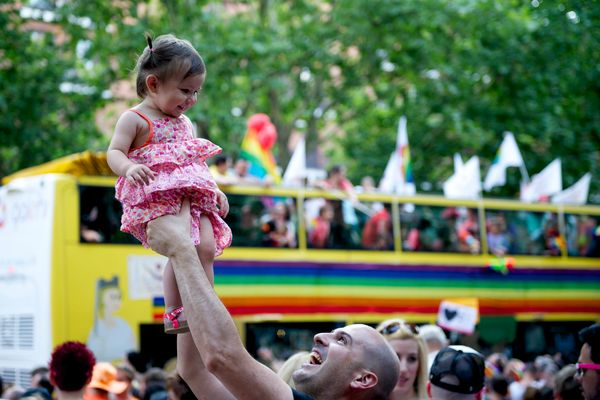 A child with her father takes part in the Gay Pride parade in Madrid on July 5, 2014 in Madrid, Spain. (Photo by Juan Naharro