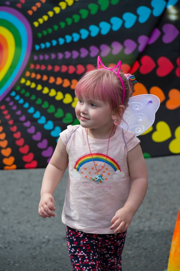 A child is dressed up in rainbow colors during the Belfast Pride parade and festival on August 6, 2016 in Belfast, United Kin