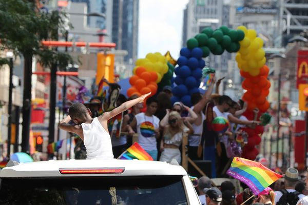 A young boy dabs during the 2016 Toronto Pride parade along Yonge Street in Toronto on July 3, 2016. (Steve Russell/Toronto S