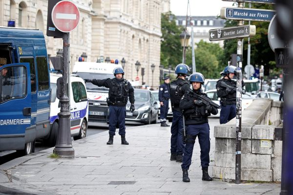 French gendarmes and police stand at the scene of a shooting incident near the Notre Dame Cathedral.