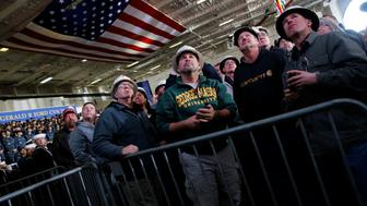 Shipbuilding workers watch on a video screen as U.S. President Donald Trump concludes his remarks aboard the pre-commissioned U.S. Navy aircraft carrier Gerald R. Ford at Huntington Ingalls Newport News Shipbuilding facilities in Newport News, Virginia, U.S. March 2, 2017. REUTERS/Jonathan Ernst