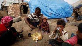 "A family eat breakfast outside their hut at a camp for people displaced by the war near Sanaa, Yemen September 26, 2016. REUTERS/Khaled Abdullah    SEARCH ""FAMINE YEMEN"" FOR THIS STORY. SEARCH ""WIDER IMAGE"" FOR ALL STORIES.   TPX IMAGES OF THE DAY"
