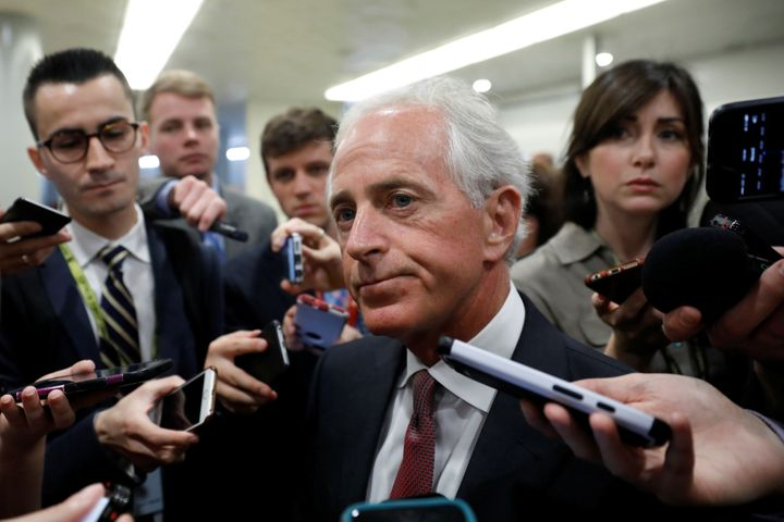 Sen. Bob Corker (R-Tenn.), unamused, talks to reporters about President Donald Trump's latest Twitter rant.